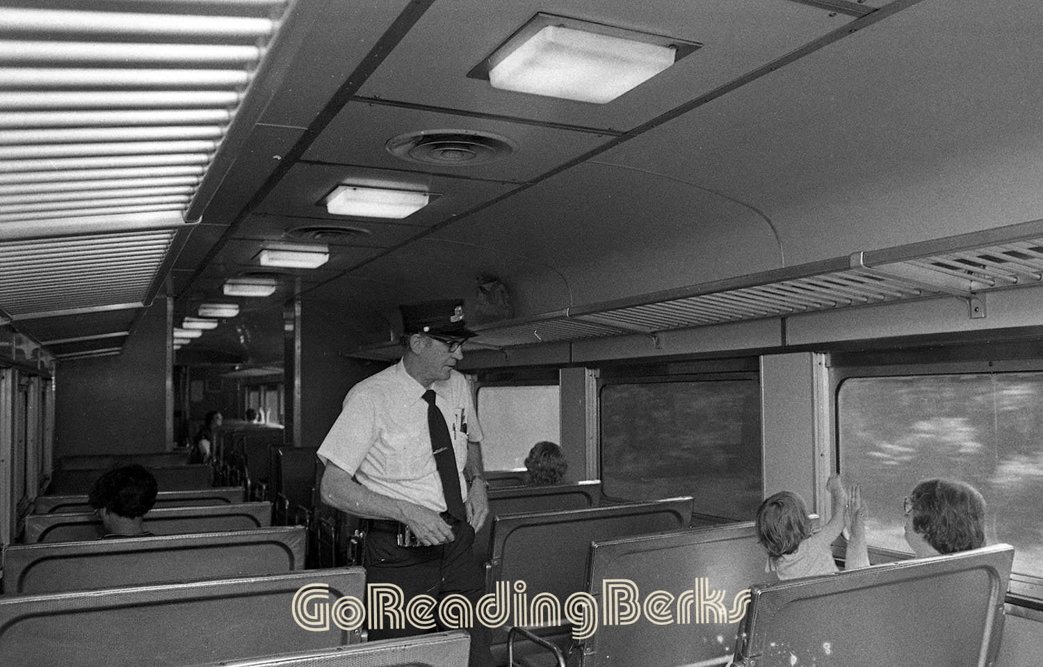 Conductor checking tickets